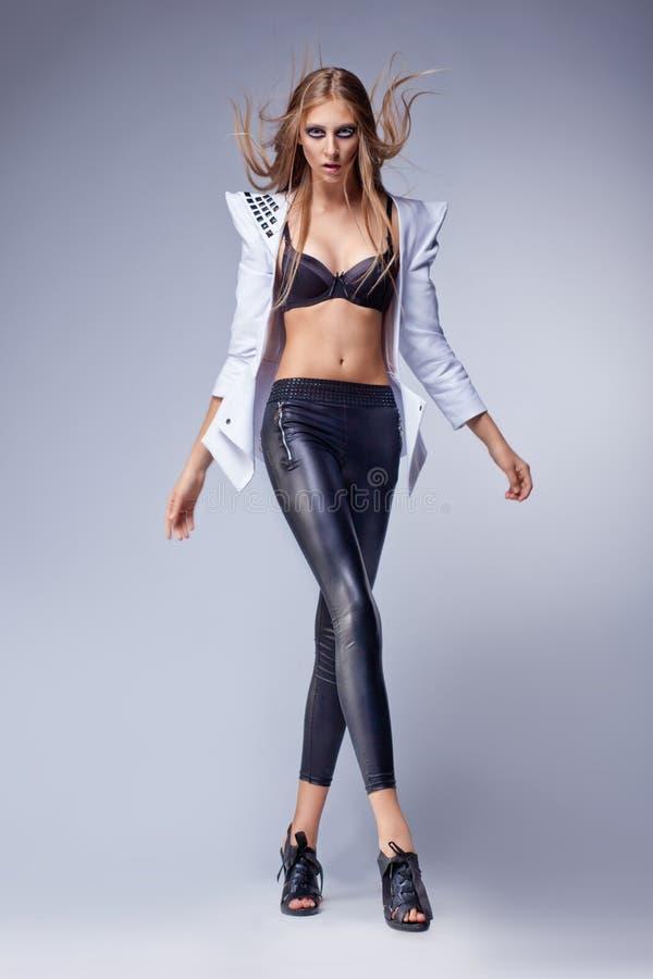 Dancing fashion provocative bright girl in leggins