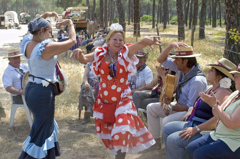 Dancing female pilgrims on their way to El Rocio stock images