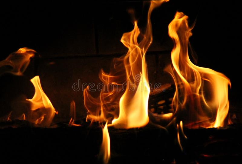 Dancing flames of fire stock image
