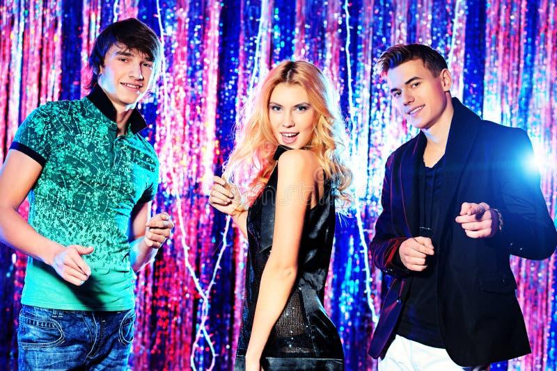 Dancing friends stock photos