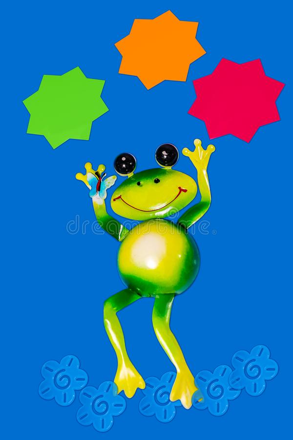 Dancing frog on blue background with three solid color stars above for text or images. A Dancing frog on blue background with three solid color stars above for royalty free stock photos