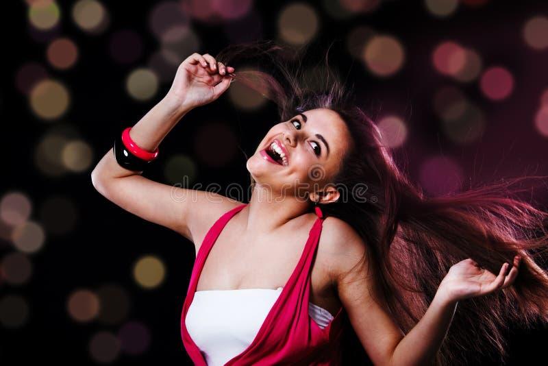 Dancing girl. Teenage happy girl with long hair, dancing stock photos