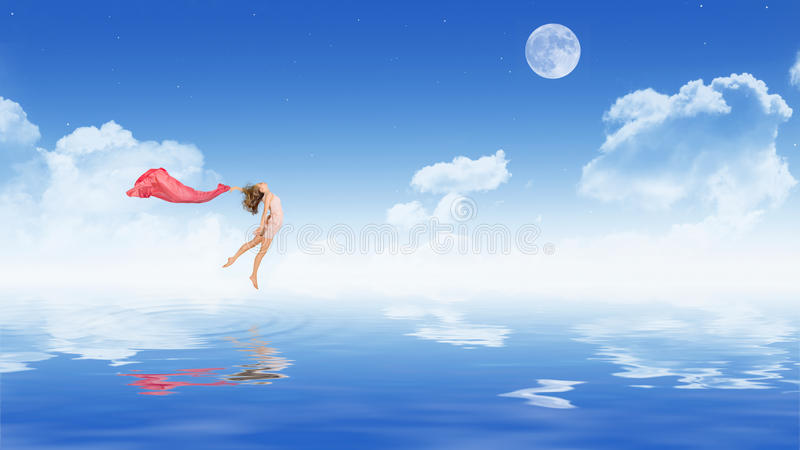 Dancing girl in dress on water surface stock photos