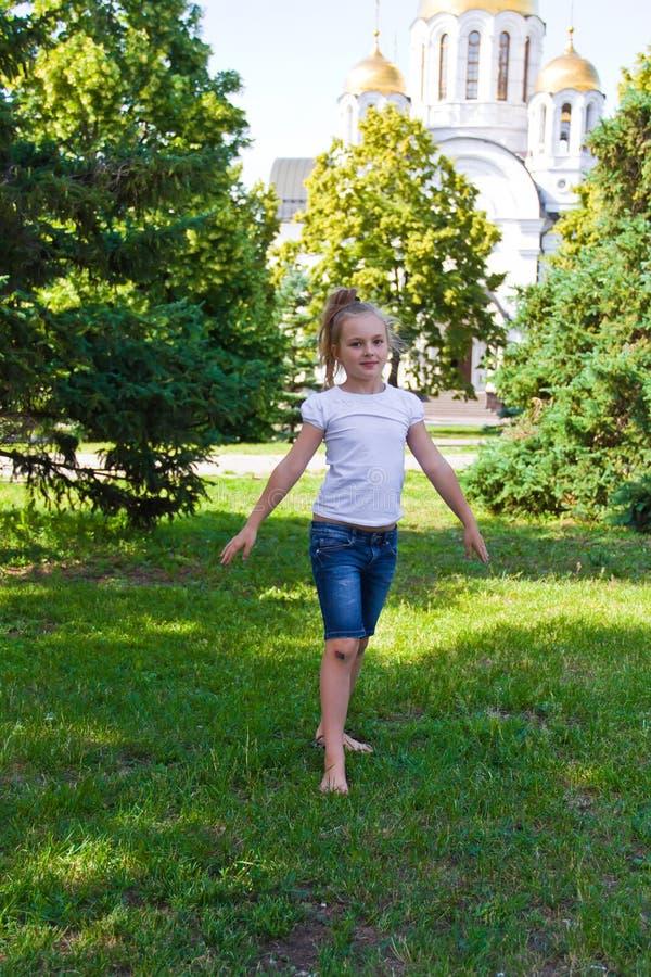 Dancing girl with sore knee. Photo of dancing girl with sore knee in summer stock photography