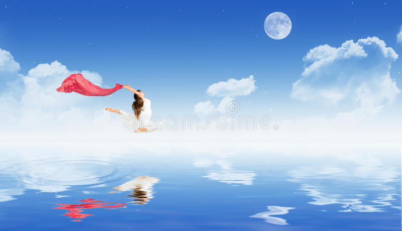 Dancing girl on water surface royalty free stock photography