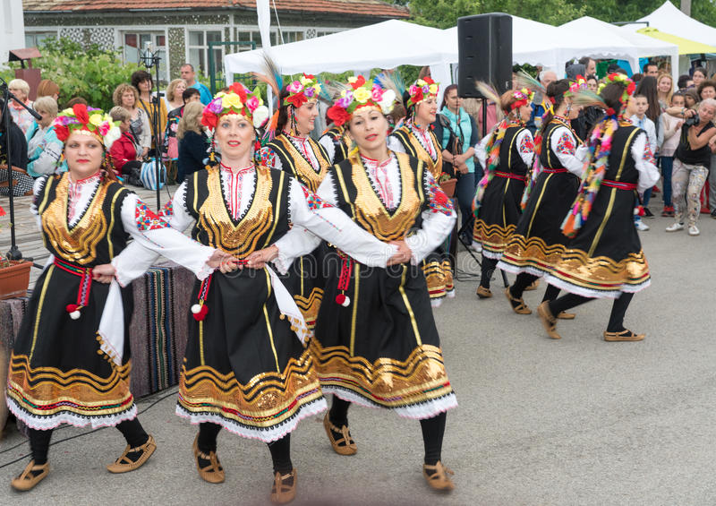 Dancing girls in a national costume at the Nestinar Games in the village of Bulgarians, Bulgaria royalty free stock photo