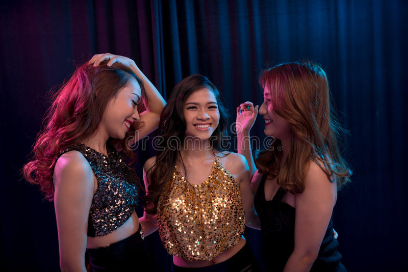 Dancing girls. Vietnamese young girls laughing when dancing together royalty free stock images