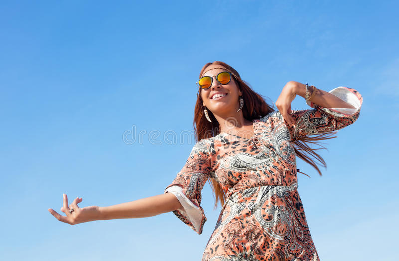 Dancing hippy girl with copy space in blue sky outdoor in summer royalty free stock photos