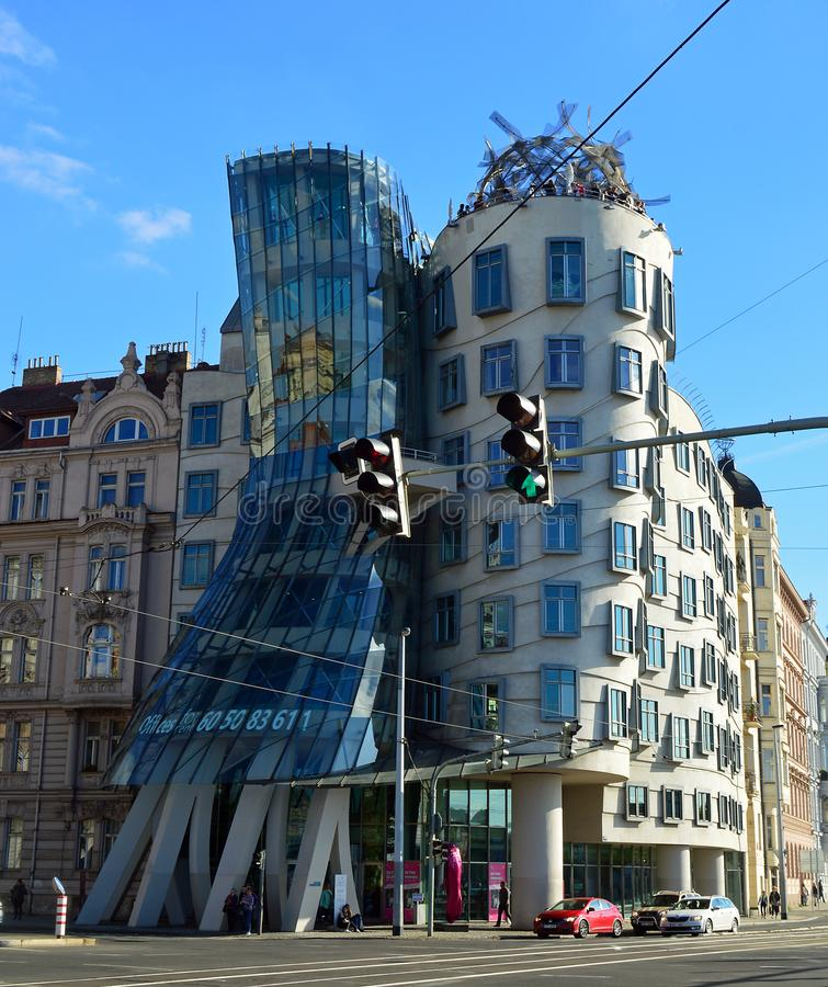 Dancing house by Frank Gehry in Prague. Dancing house or Fred and Ginger building in downtown Nove Mesto, New Town area. Prague, Czech Republic. Traffic Lights stock photo