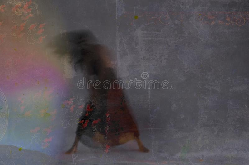Dancing Light And Shadow Woman. Motion Blur Shadow woman leaning into rainbow and flame light. Photo based illustration royalty free stock images