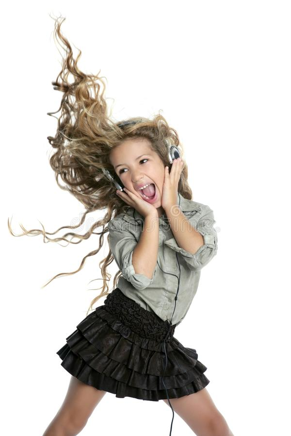 Dancing little blond girl headphones music singing royalty free stock photography