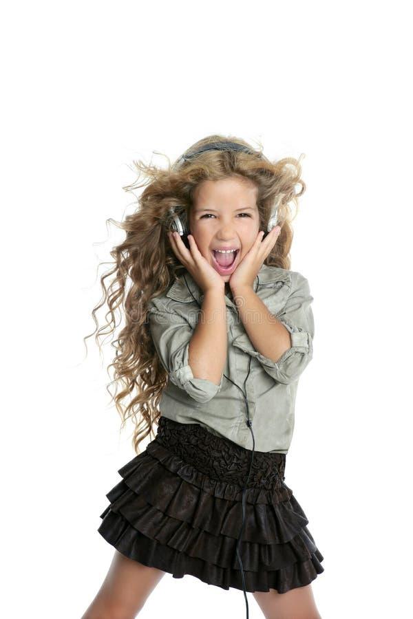 Dancing little blond girl headphones music singing stock photography