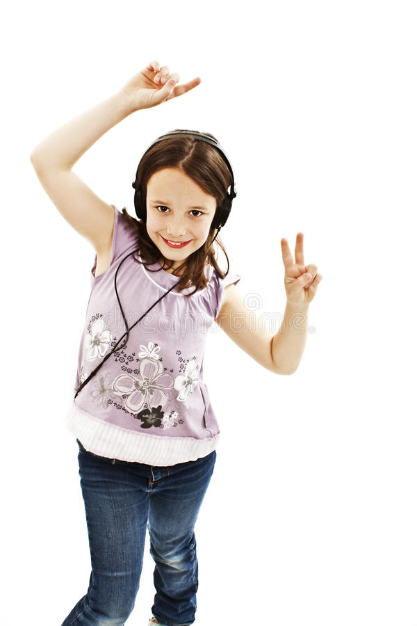 Dancing little girl headphones music stock images