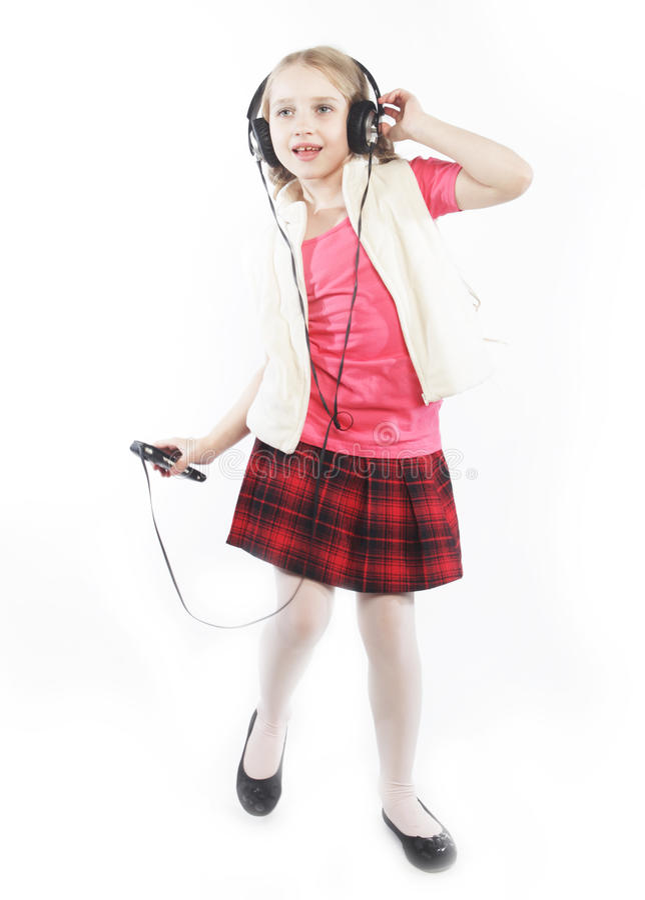 Dancing little girl headphones music singing royalty free stock images