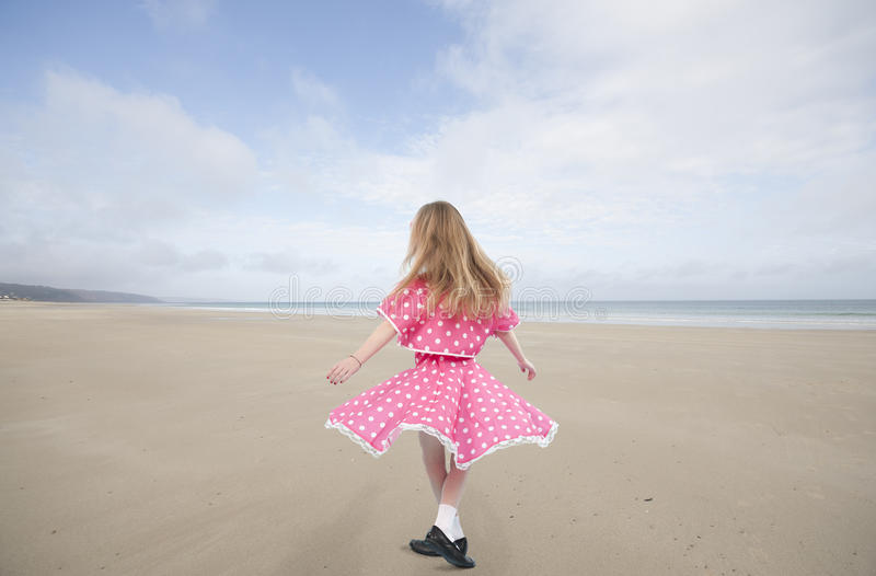 Dancing little girl in pink dress royalty free stock image