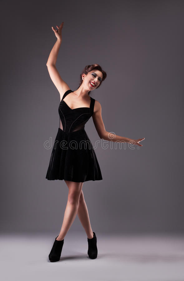 Dancing love. Happy young woman smiling while dancing