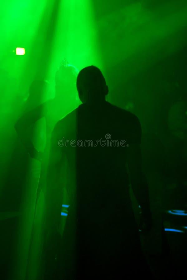 Dancing man. In an underground club stock photos