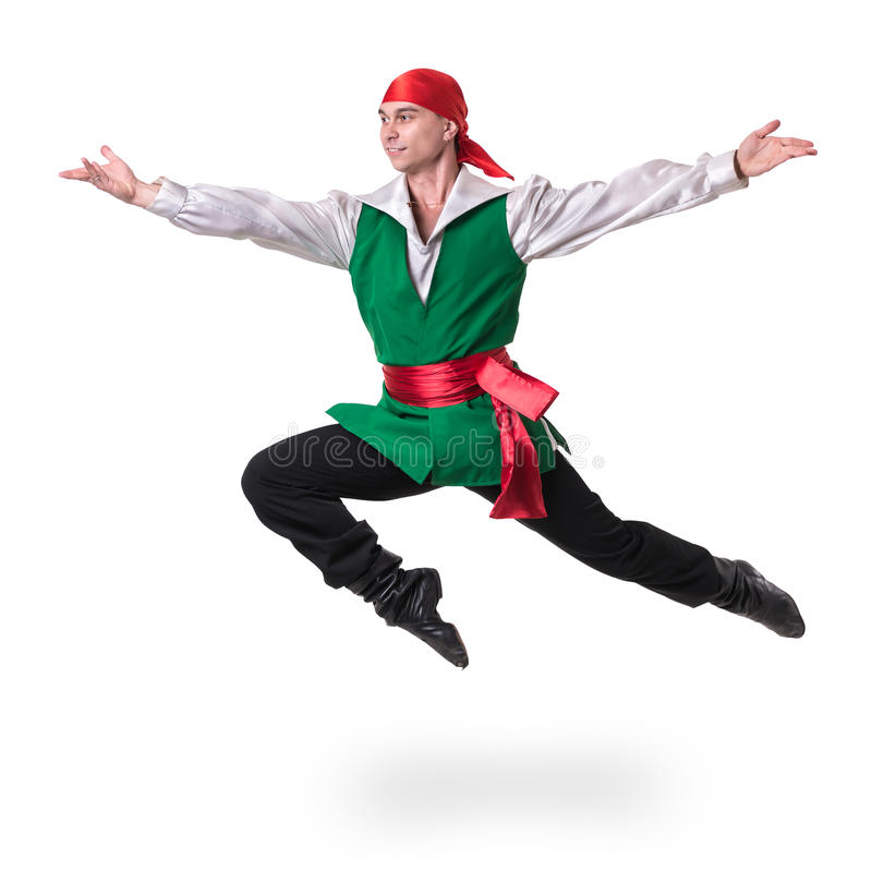 Dancing man wearing a pirate costume jumping, isolated on white in full length. stock photography