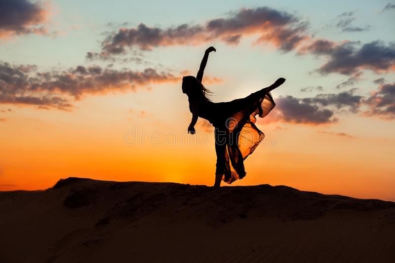 Dancing at night on the sand. royalty free stock photo