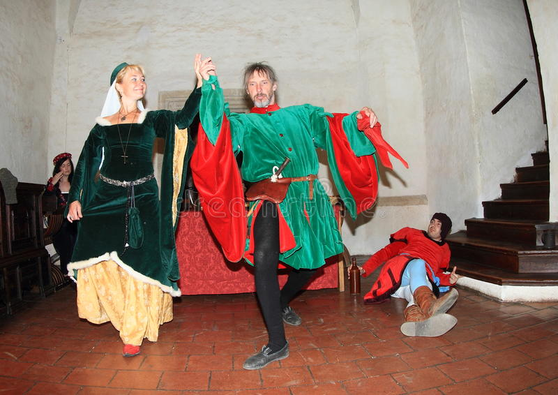 Dancing nobles. Owner of castle Puta dancing with his wife in banquet hall during Night performance A dozen small kegs or Cases of dead burgrave on castle Svihov stock images