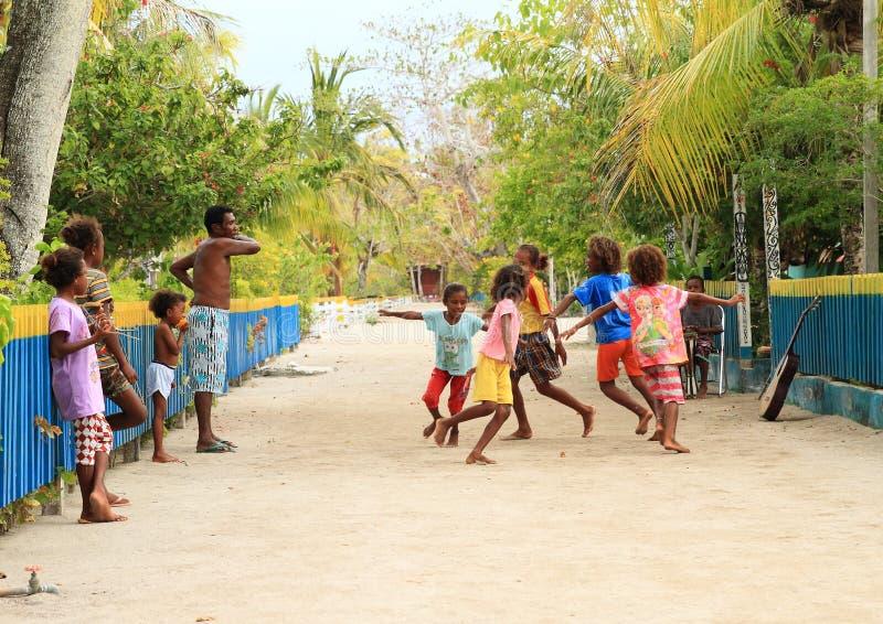Dancing Papuan kids stock image