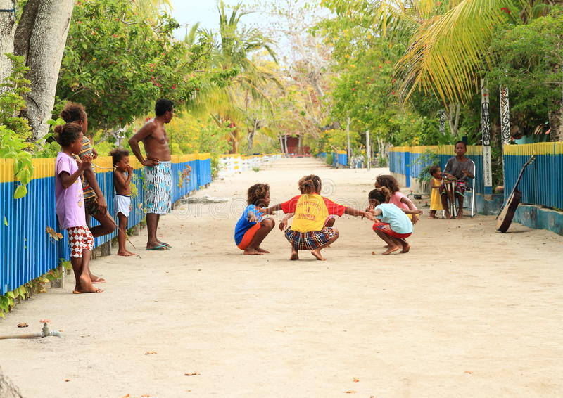 Dancing Papuan kids stock images
