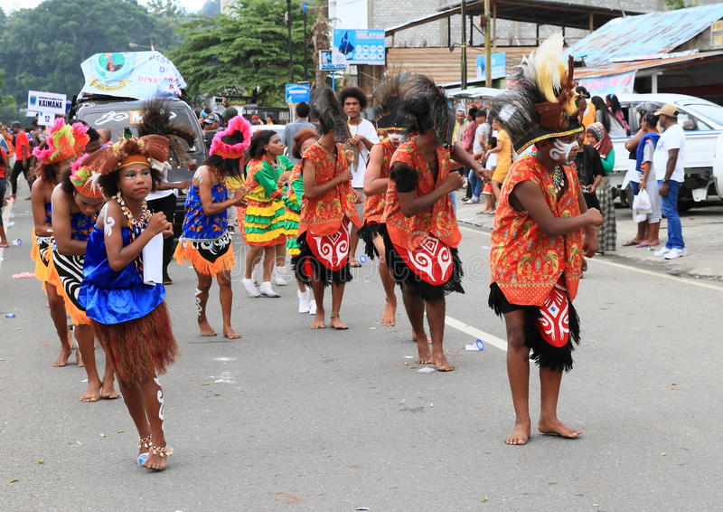 Dancing Papuan women in traditional clothes and face paintings royalty free stock photo