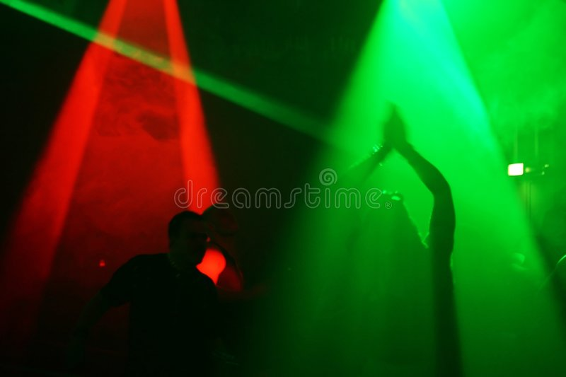 Dancing people. In an underground club stock photo