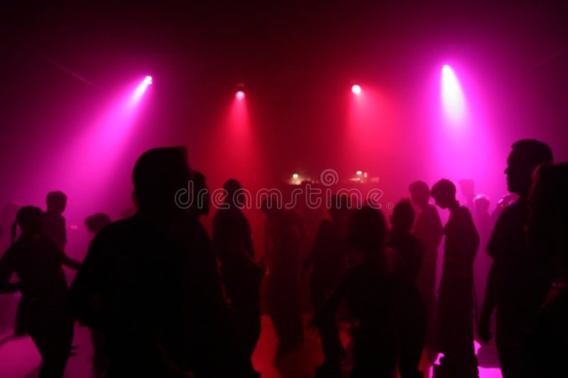 Dancing people. In an underground club royalty free stock images