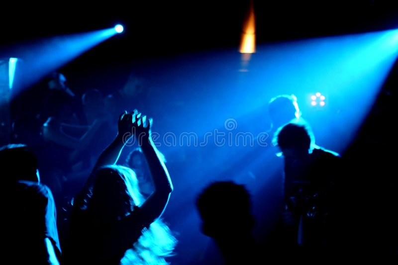 Dancing people. In an underground club stock photos