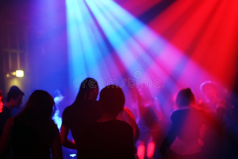 Dancing people. In an underground club stock images