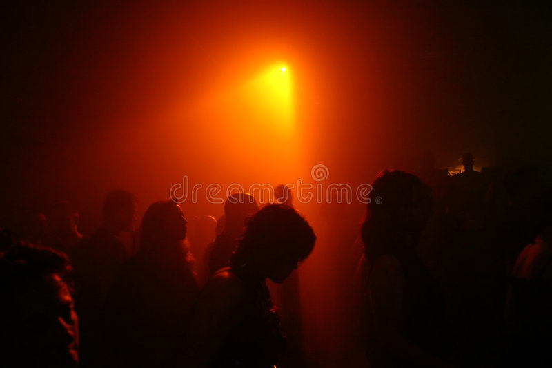 Dancing people. In an underground club stock photography