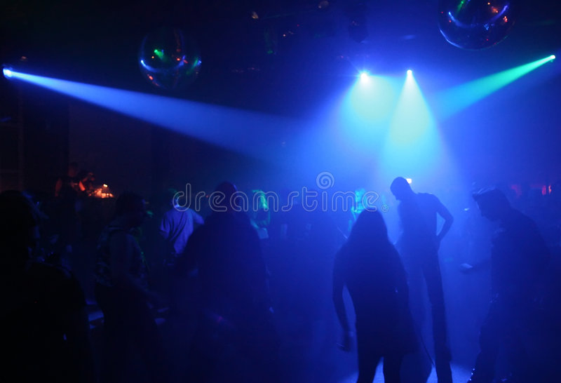 Dancing people. In an underground club royalty free stock photography