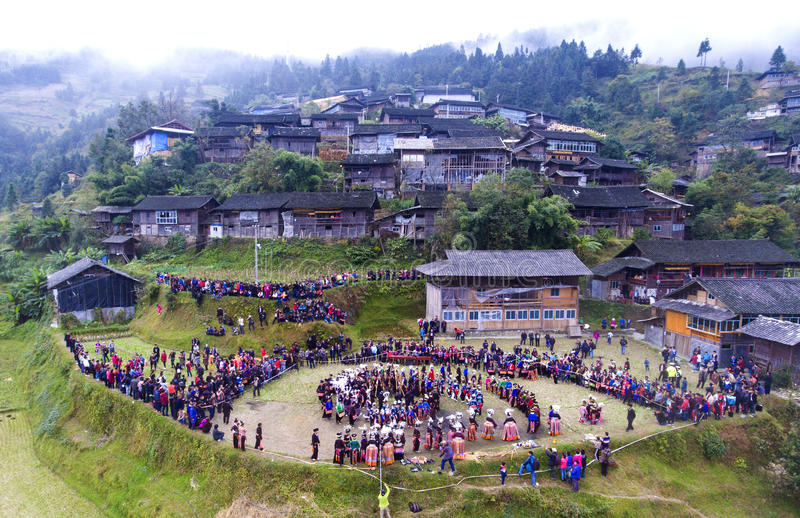 """Dancing people & their village. Miao people are dancing——""""Pheasant dance""""at land of their village stock photography"""