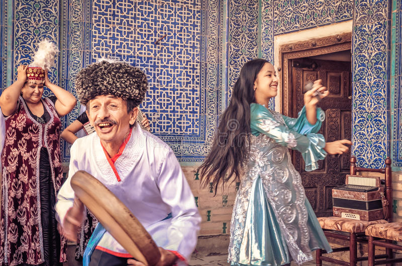 Dancing people in Uzbekistan royalty free stock image