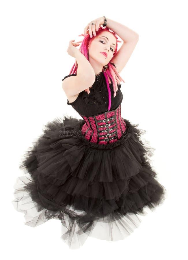 Dancing pink hair girl stock photography