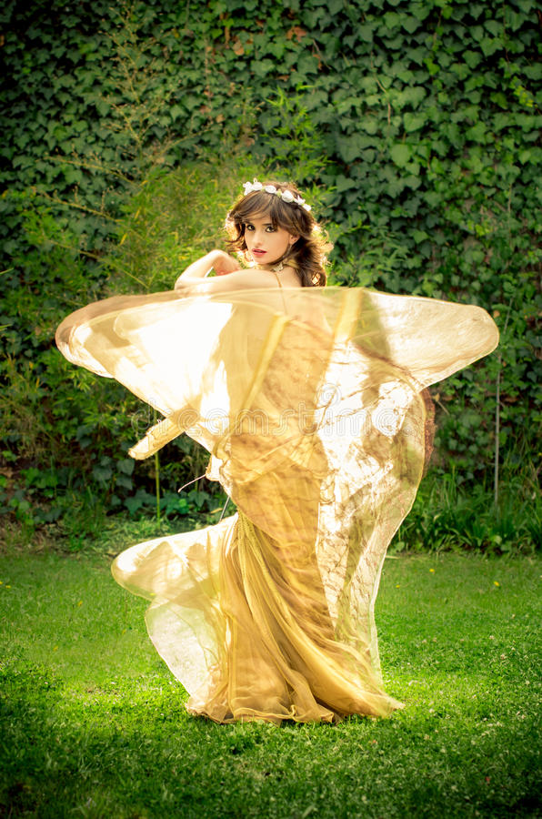 Dancing princess in the park. This image has attached release royalty free stock images