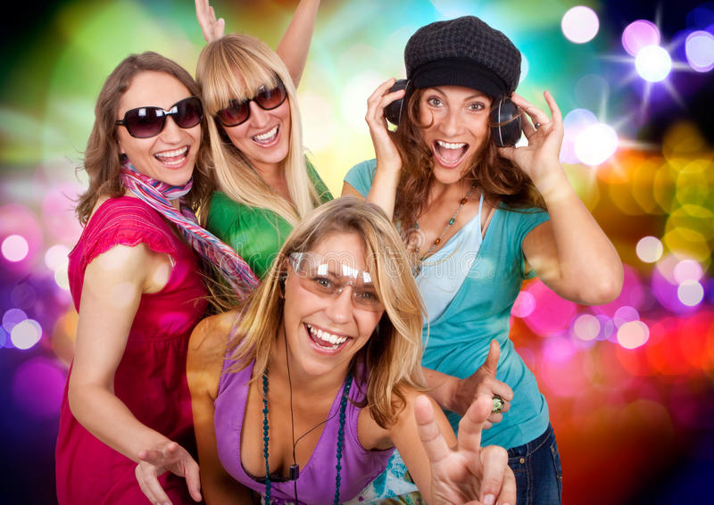 Dancing queens 1. Three beautiful girls making party stock image