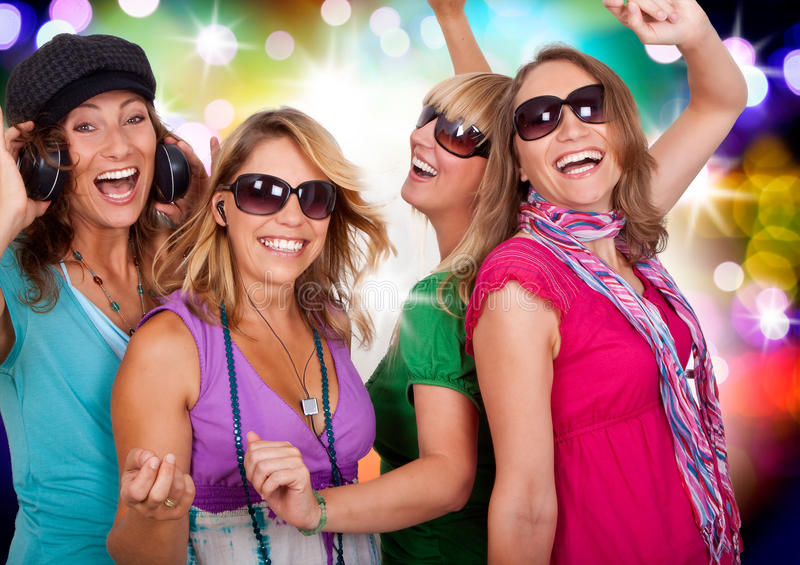 Dancing queens 4. Three beautiful girls making party stock photos