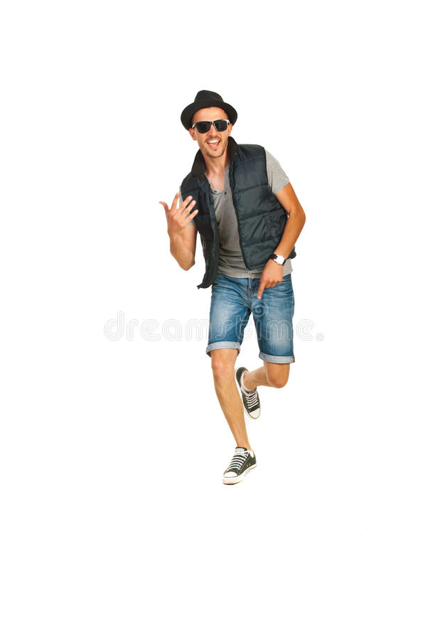 Dancing rapper man. Dancing cheerful rapper man isolated on white background stock photography