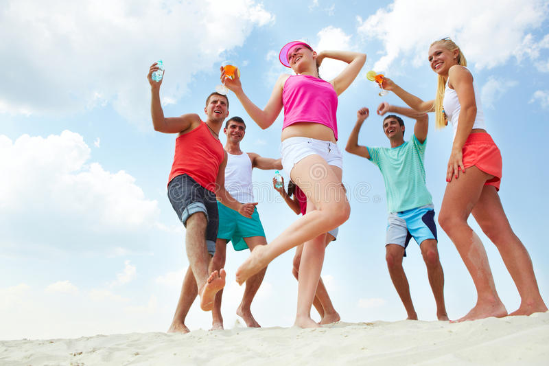 Download Dancing on sand stock image. Image of energetic, group - 22576951