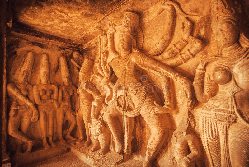 Dancing Shiva Lord sculpture with many dands on wall of old relief. Ancient Indian architecture in Aihole, India.  stock image