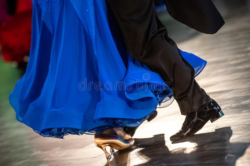 Dancing shoes feet and legs of female and male couple ballroom. Dancing shoes feet and legs of female and male couple stock images