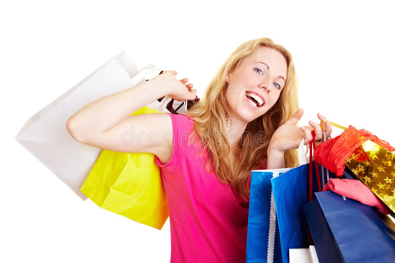 Dancing with shopping bags. Happy woman with a lot of colorful shopping bags stock images