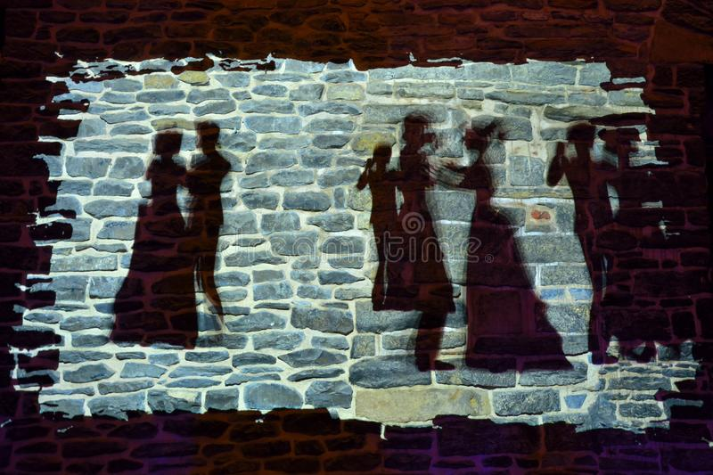 Dancing Silhouettes on a castle wall royalty free stock photos
