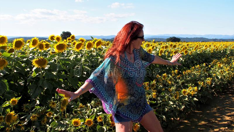 Being happy in a sunflower field royalty free stock photo