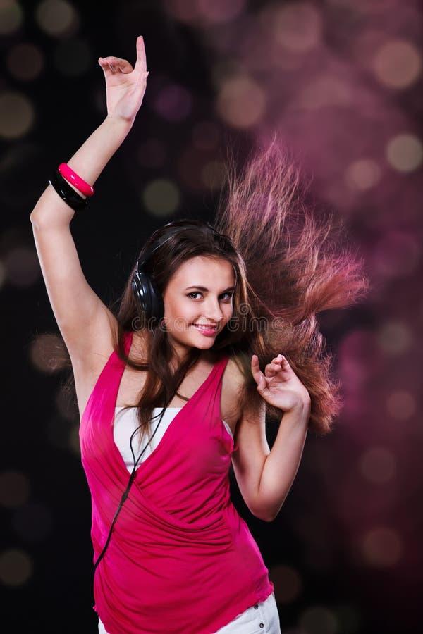 Dancing teen. In the headphones stock images