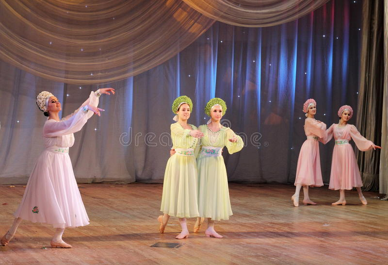 Dancing to classical music. Children's choreographic team of folk dance on the stage of the Kyiv Palace iyunoshestva children. Festival Your Olympus stock photo