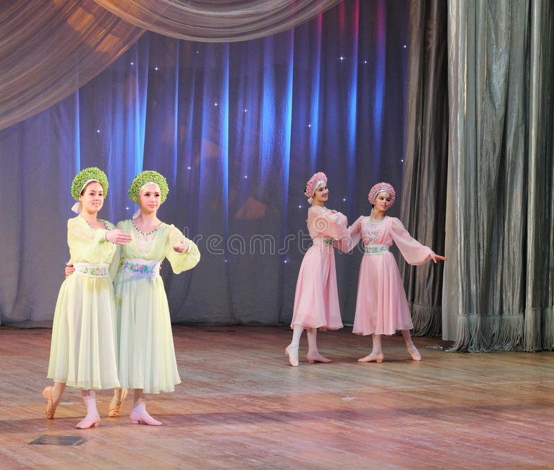 Dancing to classical music. Children's choreographic team of folk dance on the stage of the Kyiv Palace iyunoshestva children. Festival Your Olympus stock photos
