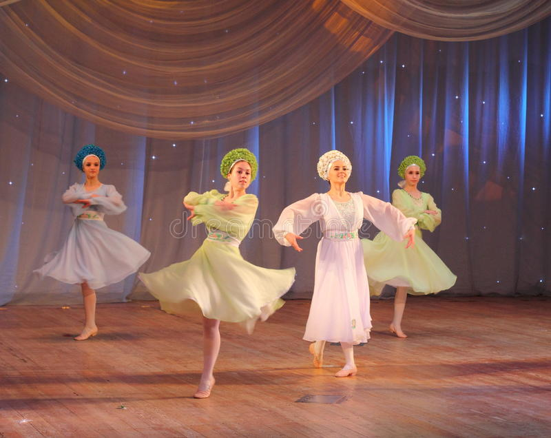 Dancing to classical music. Children's choreographic team of folk dance on the stage of the Kyiv Palace iyunoshestva children. Festival Your Olympus royalty free stock image